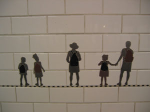 Holding hands in the subway tile mosaic