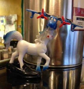 A toy horse with an airplane fixture, stands in Ken-doll plastic loafers. This sort of DIY assemblage has humor, weirdness, and possibilities that I like.